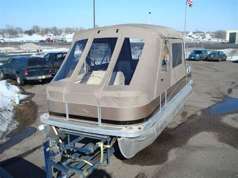 tritoon boat with cabin pontoon boat enclosures minnesota pontoon covers
