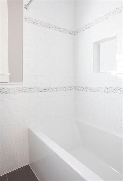 white subway tile shower with blue accent built in shower nook with white subway tiles and dark