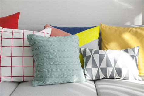 pillow arrangements on sofa wilsonart countertop prices per sq ft low maintenance