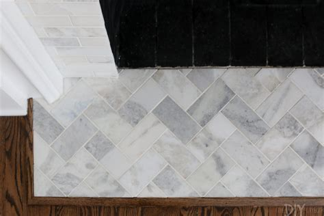 A White Marble Tile Fireplace Update   The DIY Playbook