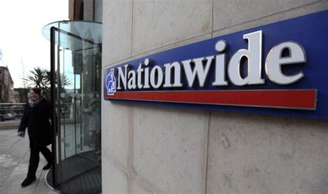 nationwide building society profits hit  fall  buy