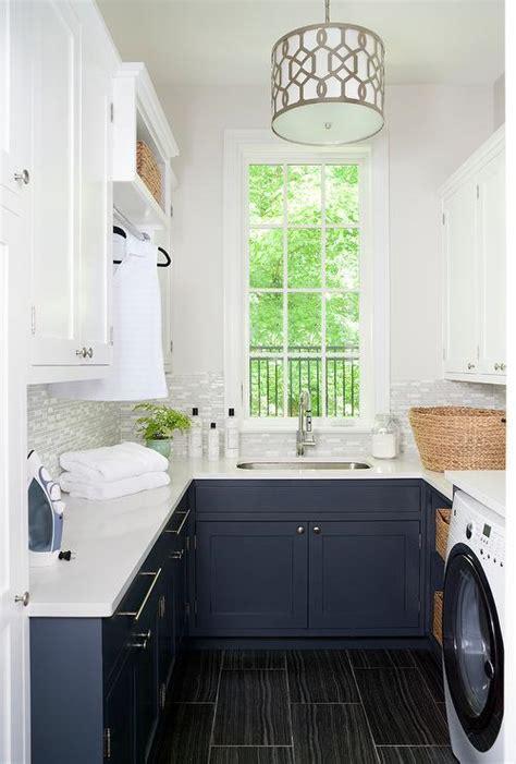 navy blue laundry room cabinets  black wood  floor