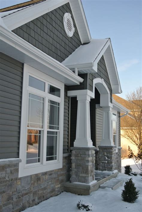 exterior stoned wainscot and front entry pillars hton