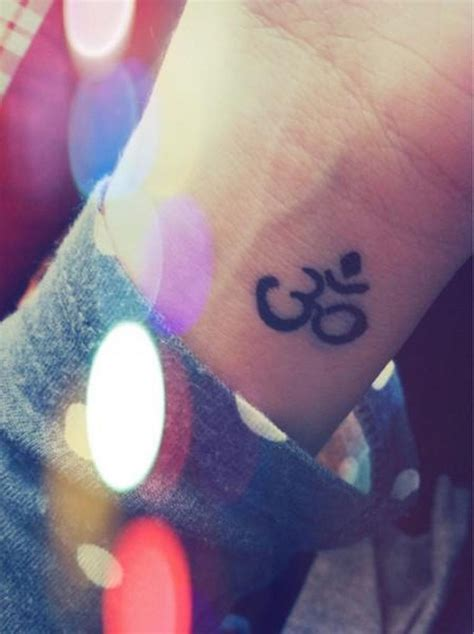om symbol tattoo 46 om on wrists