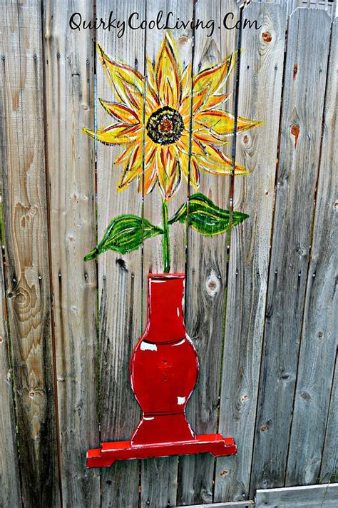 hometalk sunflower fence art  repurposed table