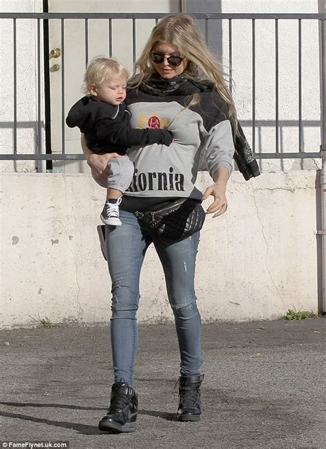 Fergie Was A Maniac by Fergie Wears A Pack So She Can Juggle Precious Cargo
