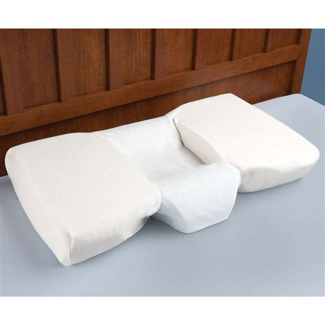 The Pillow by The Neck Relieving Pillow Hammacher Schlemmer