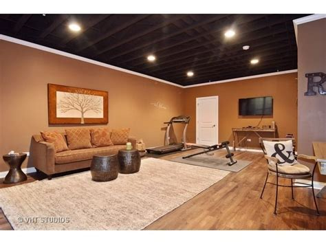 nicely finished basement with painted exposed ceiling finished basement ideas