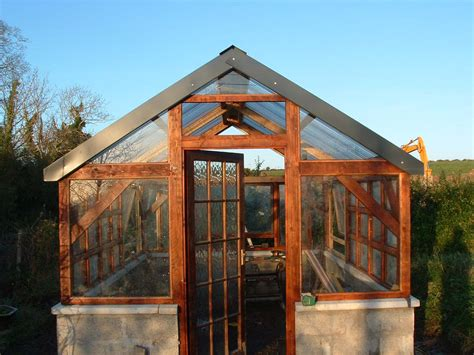 timber frame greenhouse w recycled windows felix power