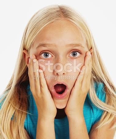 girl face pre blonde preteen girl hands to her face totally amazed stock