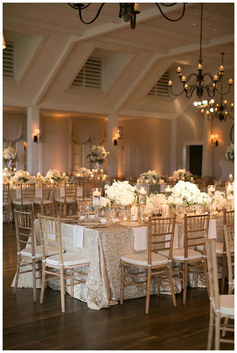 gold ivory and white wedding reception decor with white