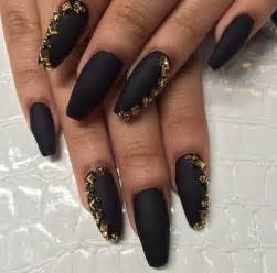Golden and black black nail art
