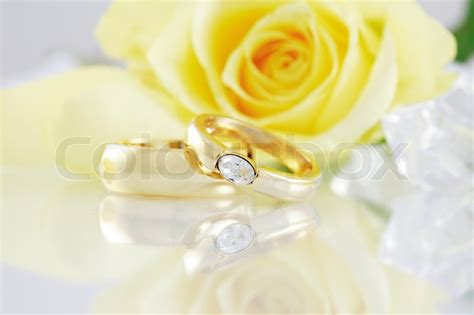 Wedding Background Design Yellow by Wedding Still With Beautiful Golden Rings Stock