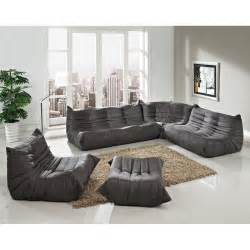 contemporary unique shape gray sectional sofa with ottoman