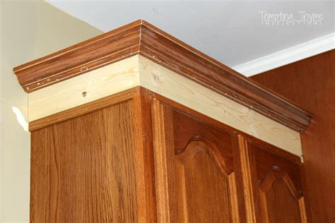 adding molding to kitchen cabinets adding height to the kitchen cabinets tempting thyme
