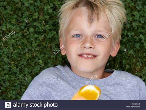 how is 8 in years blond child 6 8 year boy holds lickling and yellow stock photo