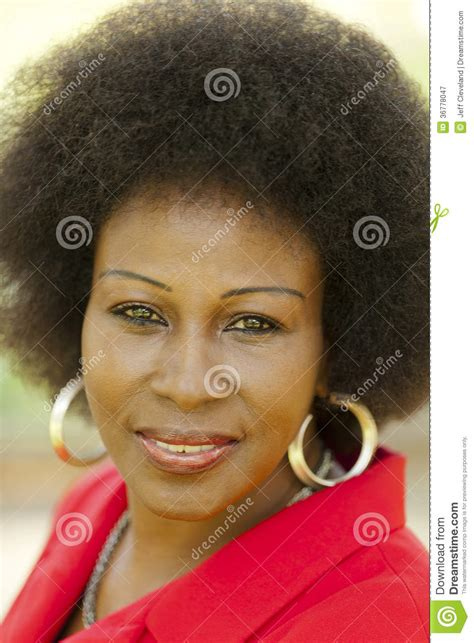 middlesge black hair do outdoor portrait older black woman red jacket royalty free