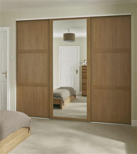 Oak Mirrored Sliding Wardrobe Doors by Oak Shaker Panel Mirror Door Sliding Wardrobe Doors