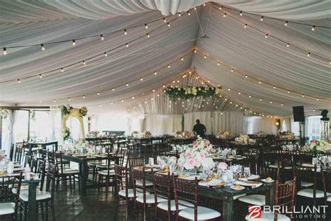 wedding tent lighting featuring market lights amber wash
