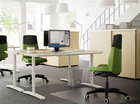 a workspace with bekant desks in birch and white and