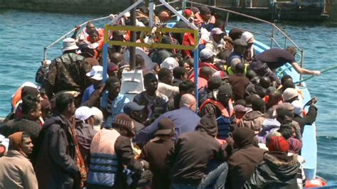 refugee boat sicily boat crammed with refugees from libya reaches tiny italian
