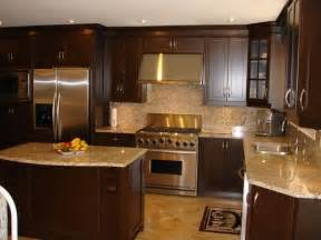 the wood cabinets light granite countertop and