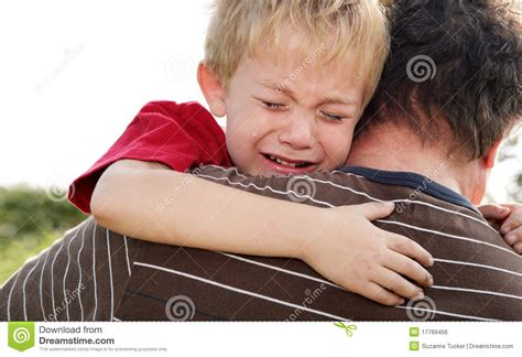 how to comfort a crying man crying boy being comforted by his father stock photo