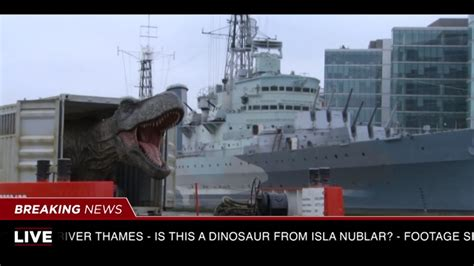 river thames jurassic world watch universal pictures transports a t rex down the