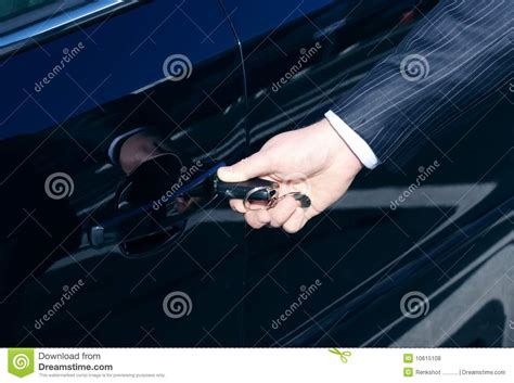 unlock door key download man driver unlocking or locking car door unlock by key royalty free stock photos image