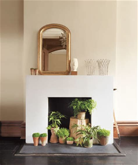 Decorating Ideas For Empty Fireplace Dress Up An Fireplace Real Simple