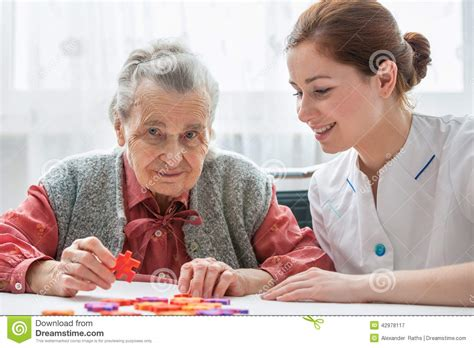house contents insurance for seniors senior woman with her elder care nurse stock photo image 42978117