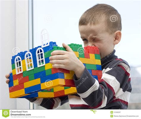 toy house for boy a boy and a toy house royalty free stock photography image 13185337