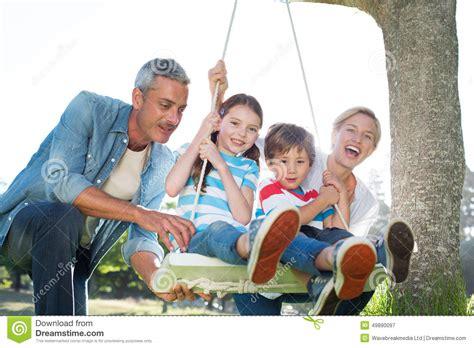 family swing happy family swing stock photo image 49890097