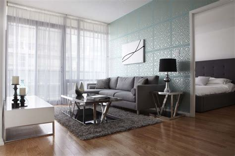 wallpaper grey sofa contemporary living room with turquoise geometric