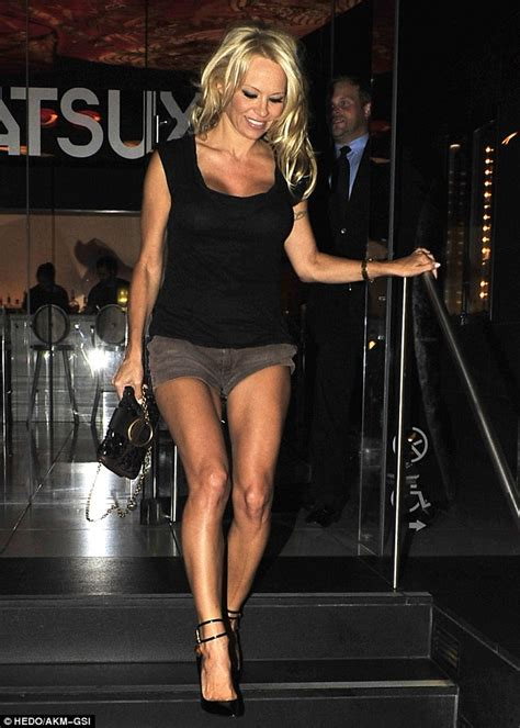 hollywood actress legs pamela anderson flashes legs and smile as she leaves