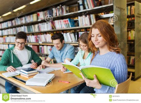 pictures of students reading books happy students reading books in library stock photo