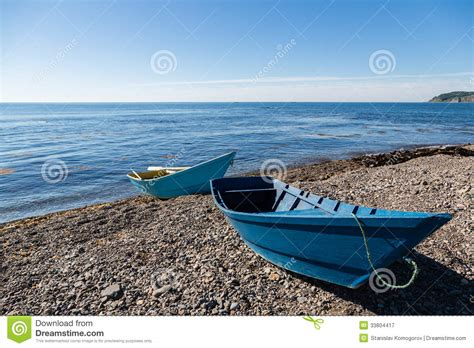 pebble art fishing boat wooden fishing boats on the sea pebble beach royalty free