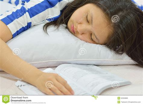 studying in bed teenage girl fall asleep while studying in bed stock photos image 32359883