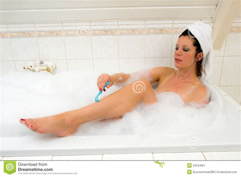 shaving in the bathtub shaving her legs stock image image 34244921