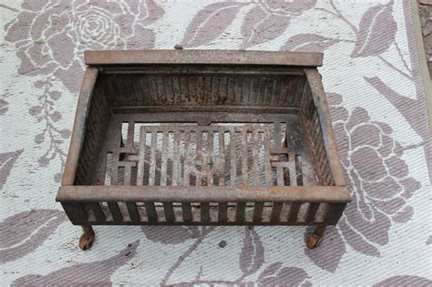 antique cast iron fireplace insert coal wood log holder w