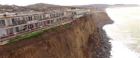 houses falling off cliffs dramatic photos show apartments just feet away from falling into the ocean abc news