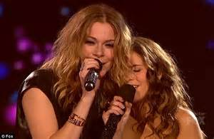 country singer with hair who s competing here leann rimes tries to out sing x