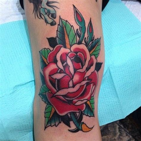 rose tattoo knee traditional style on the knee cap tattoos