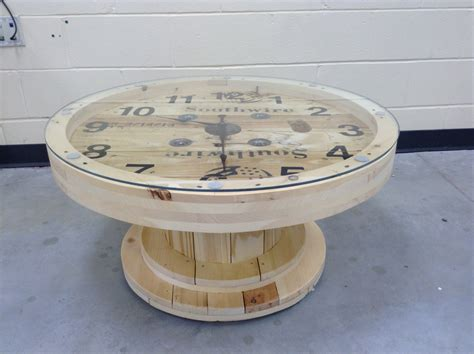 a cable wire spool made into a coffee table clock