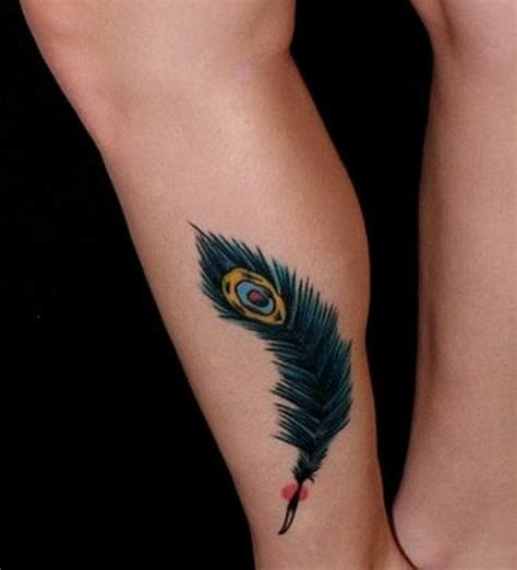 feather tattoo turquoise little turquoise colored peacock feather tattoo on shin
