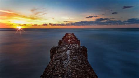 wallpaper sea sunset skyline pier  uhd
