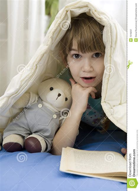 little girls sofa little girl with bear on sofa royalty free stock photography image 7519237