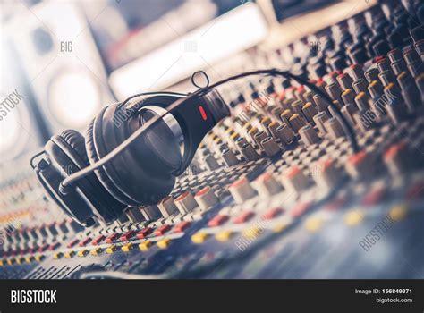 Mixer Untuk Studio Radio mixer and professional headphones in the recording studio