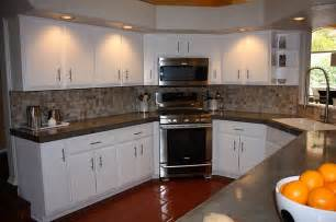 Awesome Cheap Backsplashes For Kitchens #10: White-kitchen-cabinets-with-concrete-countertops-and-mosaic-backsplash.JPG
