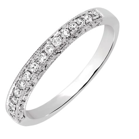 wedding band with 0 18 carat tw of diamonds in 14ct white gold